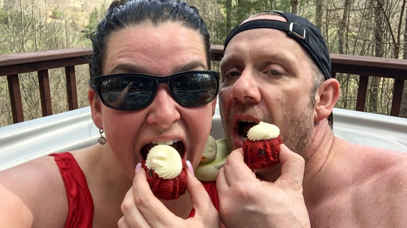 Eating cupcakes in the hot tub at our Carolina Mornings cabin.